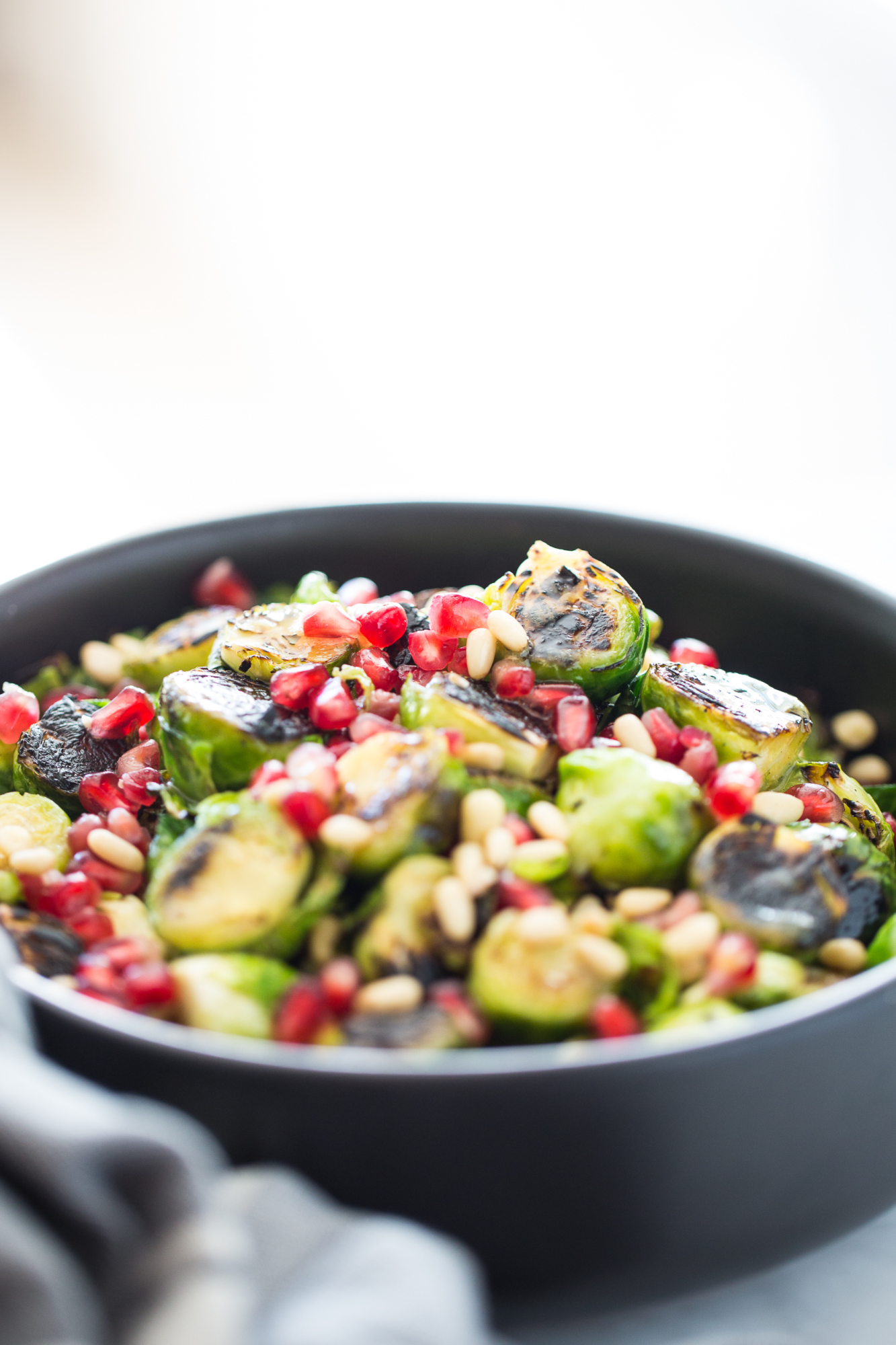 Roasted Brussels sprouts salad with agave Dijon mustard and topped with pine nuts and seeds. It is vegan and perfect for the Holidays.