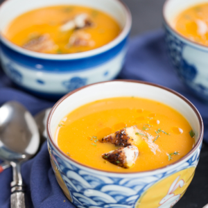 Vegan butternut squash soup with vegan grilled cheese sandwich crutons.