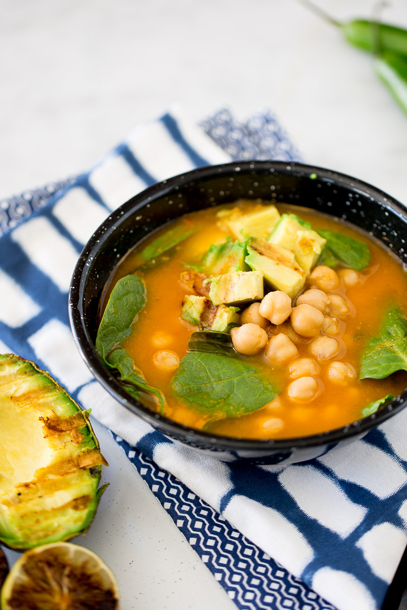 This recipe for chickpea soup spinach, roasted avocado, and charred lime is easy, hearty, vegan and very easy to prepare. #soup,#vegansoup,#veganrecipe