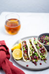 Vegan tacos with pomegrana​t​e salsa