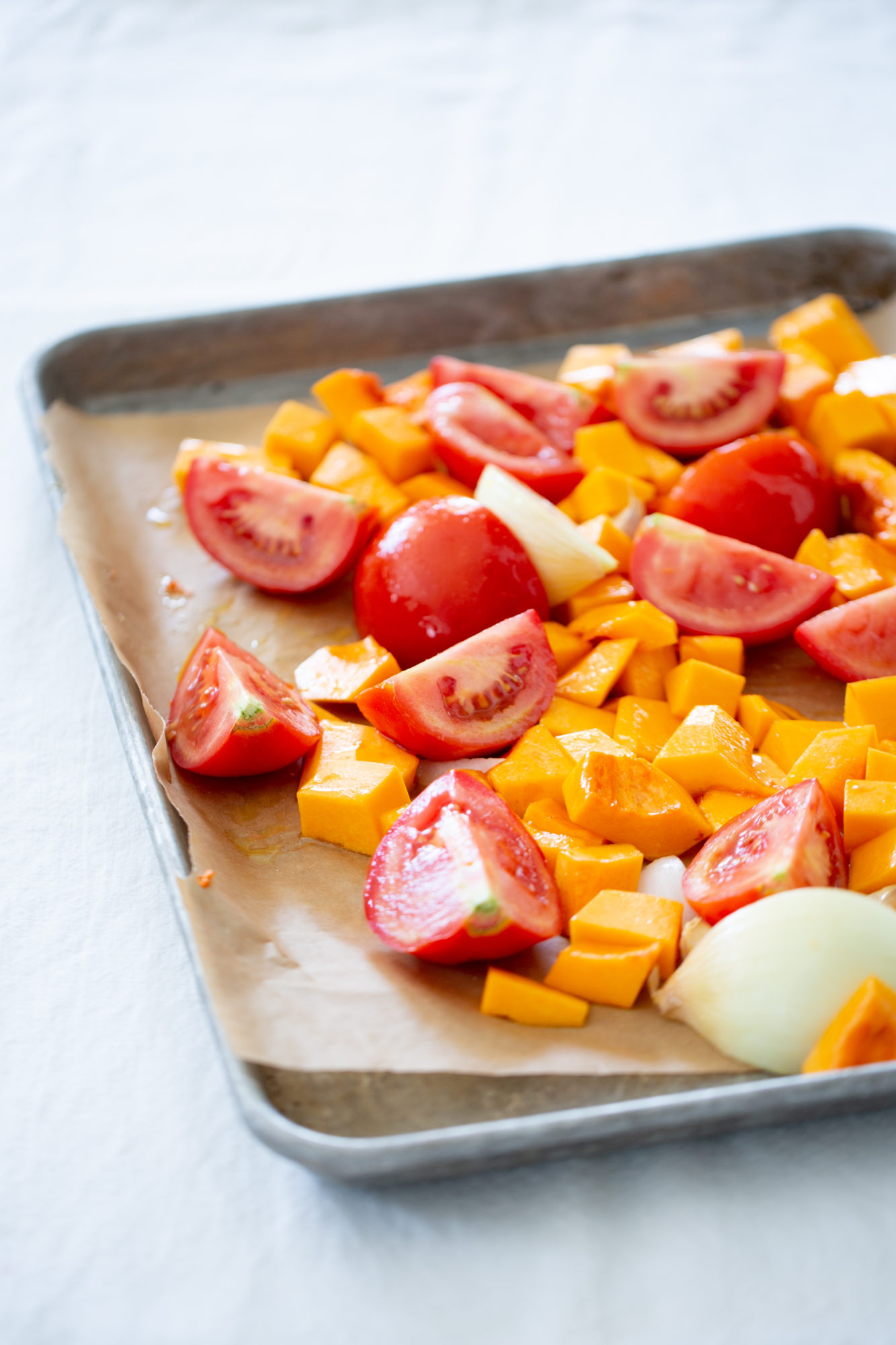 tomatoes, butternut squash, and onions before roasting