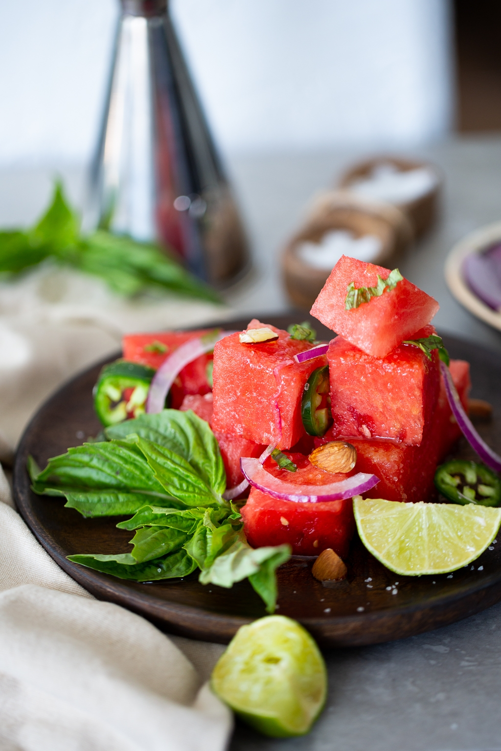 Spicy Watermelon basil salad with toasted almonds and red onion.