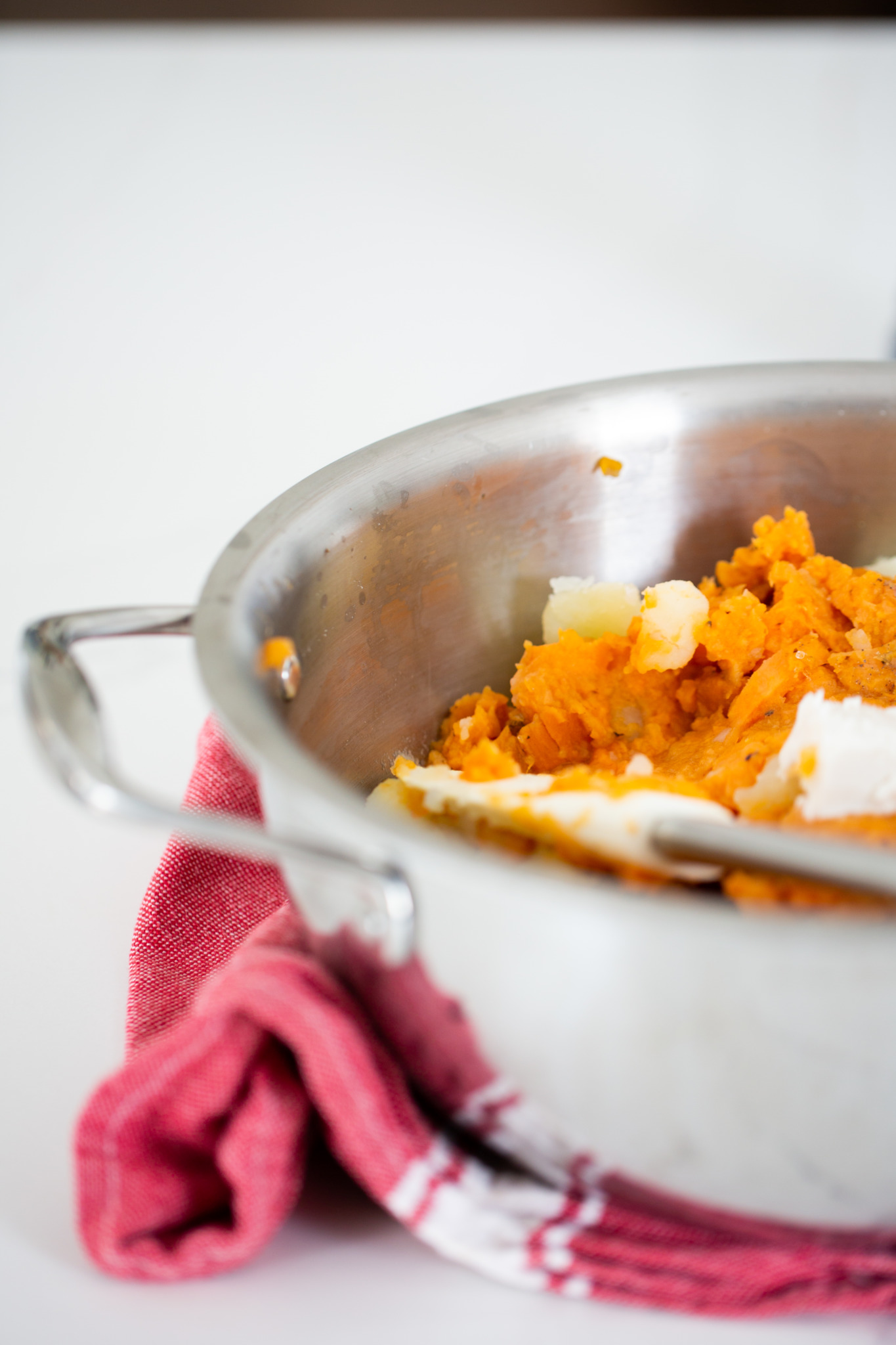 mashed potatoes and sweet potatoes in a pot