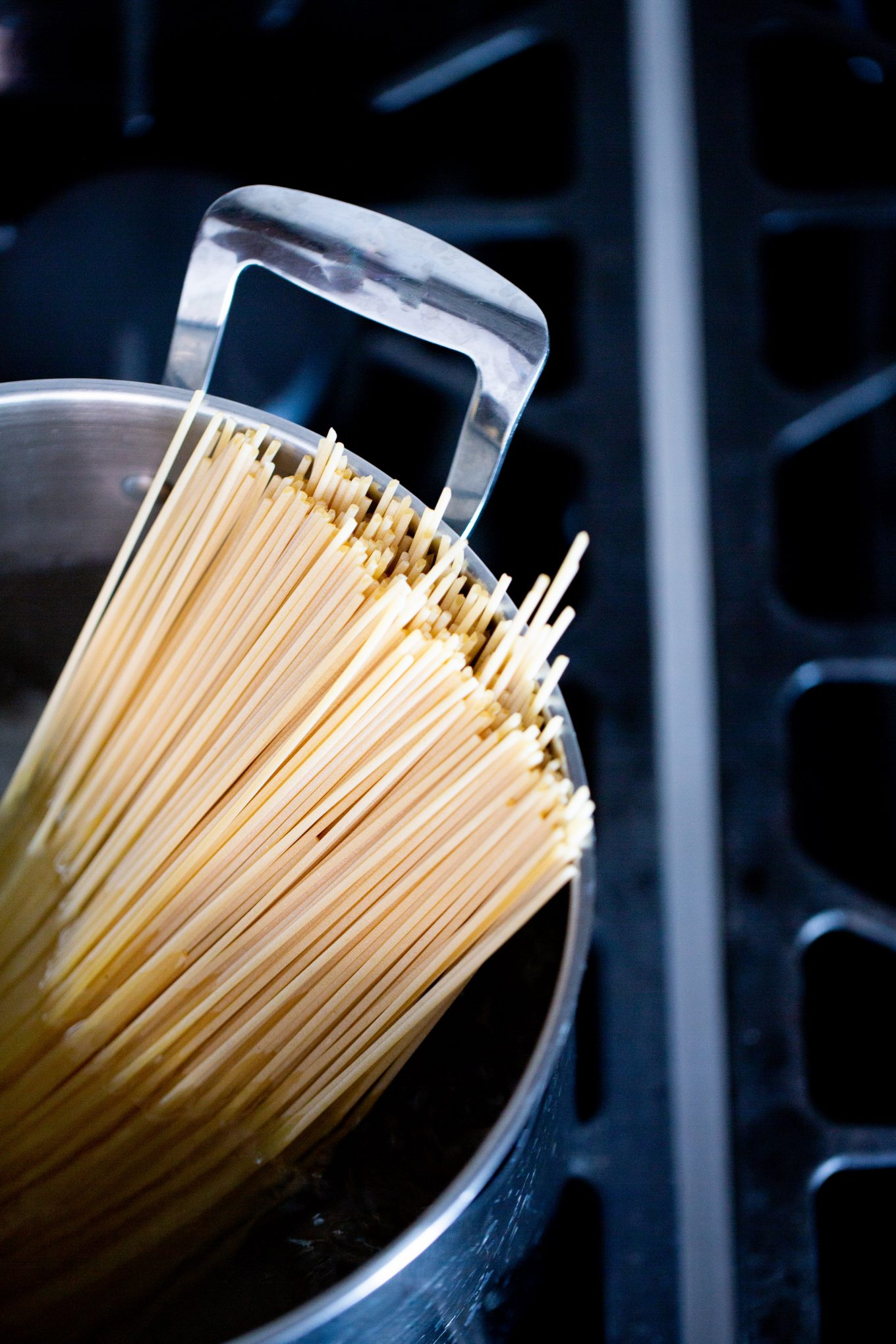 dry pasta in a pot of water