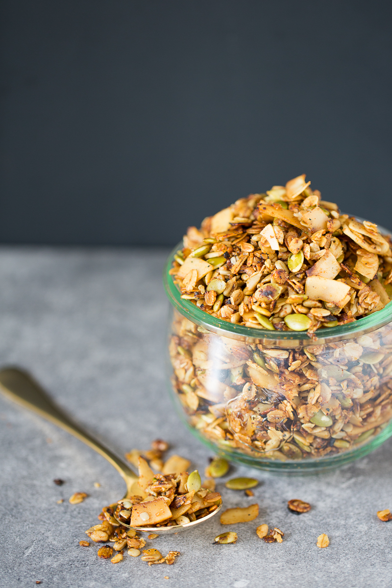 Savory and vegan granola in a glass container.