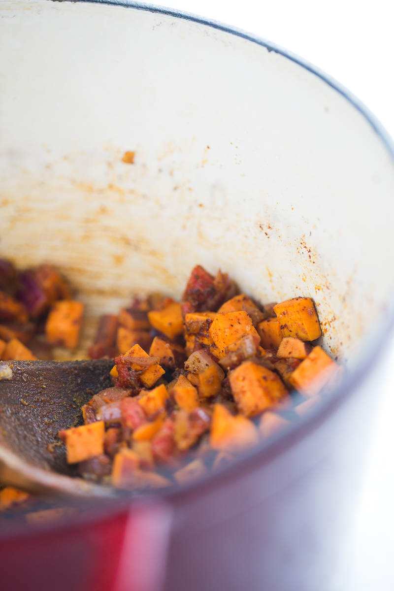 Sweet potatoes and aromatics in a pot for chili