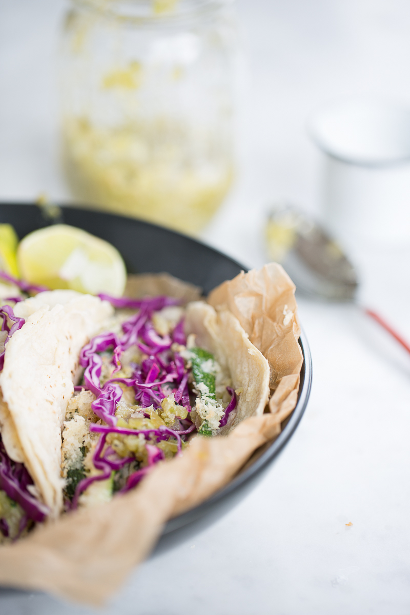 Vegan zucchini tacos with salsa verde an red cabbage