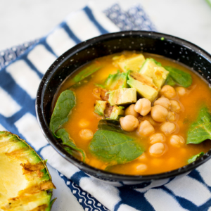Chickpea soup with roasted avocado and charred lime