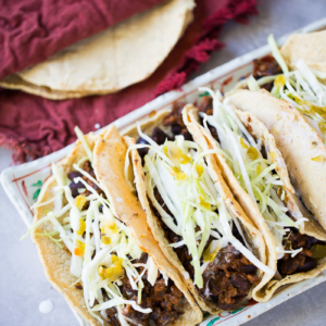 Vegan Mexican tacos recipe with corn tortillas and black beans with chorizo.