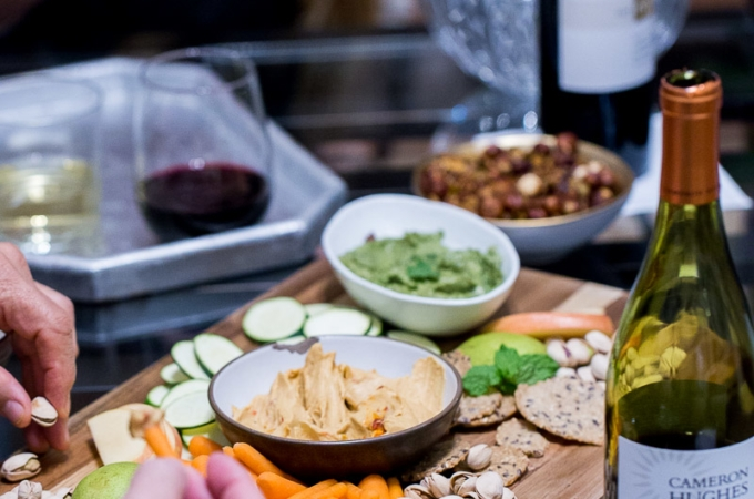 Friends, a veggie plater with spicy candied nuts and good wines.