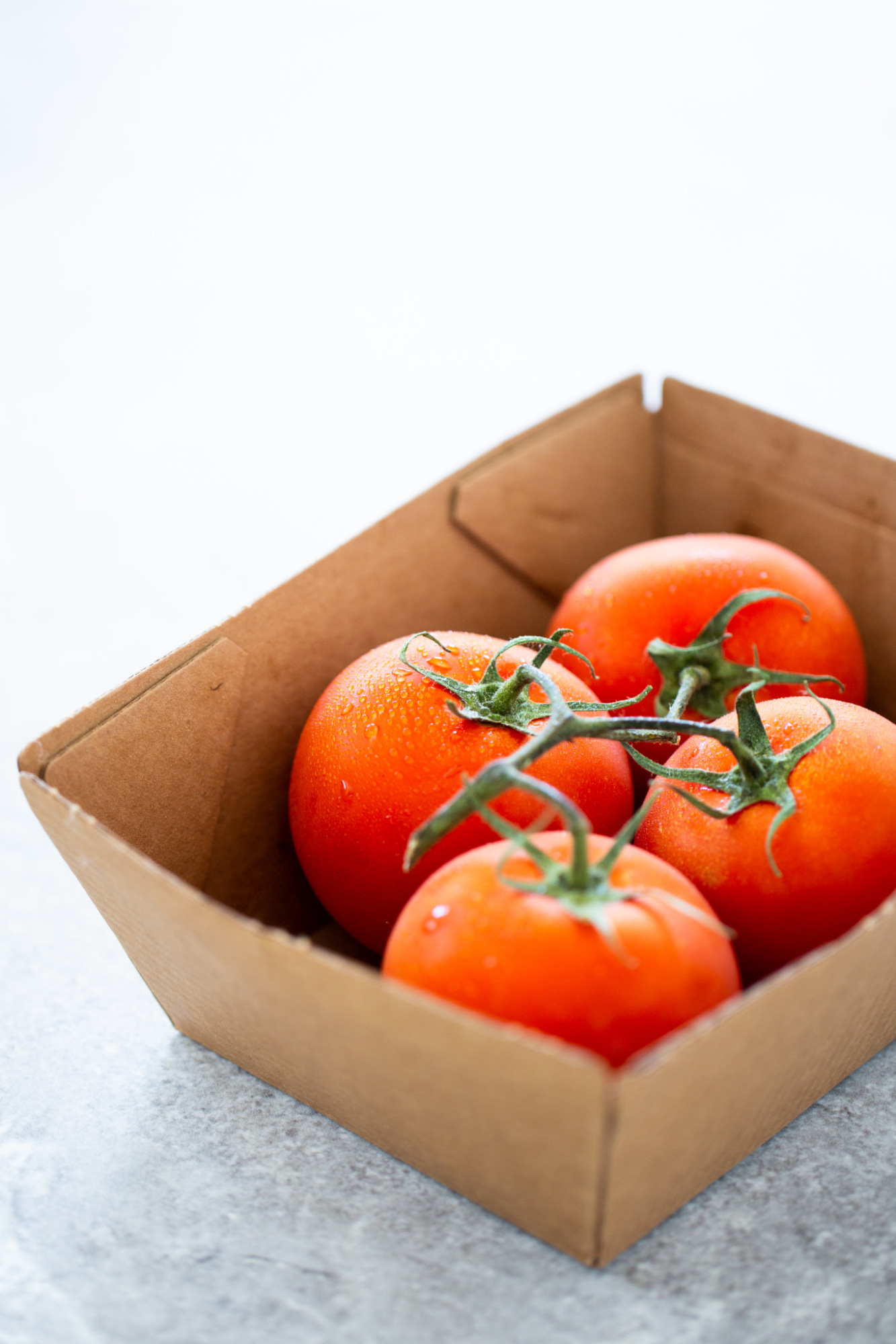 tomatoes in a box  for enchilada sauce