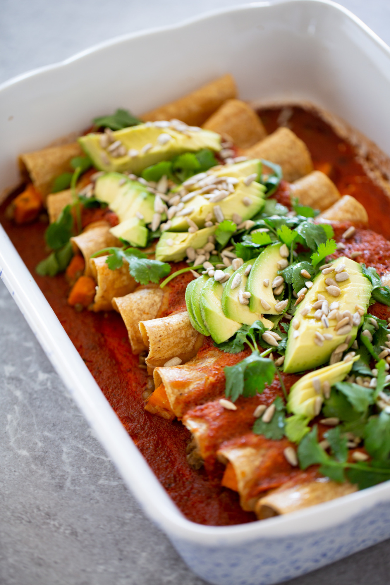 vegan enchiladas filled with lentils and sweet potatotoes