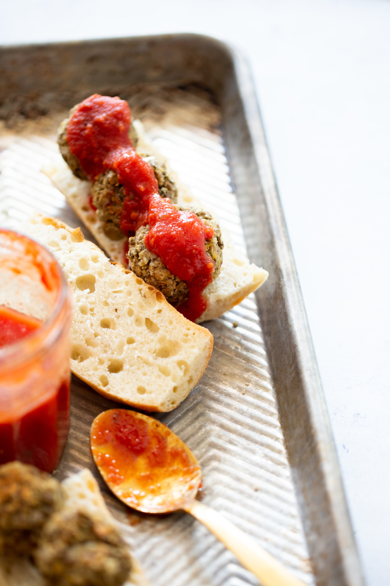 An open meatball sub with the vegan meatballs covered with a a five minute marinara sauce.