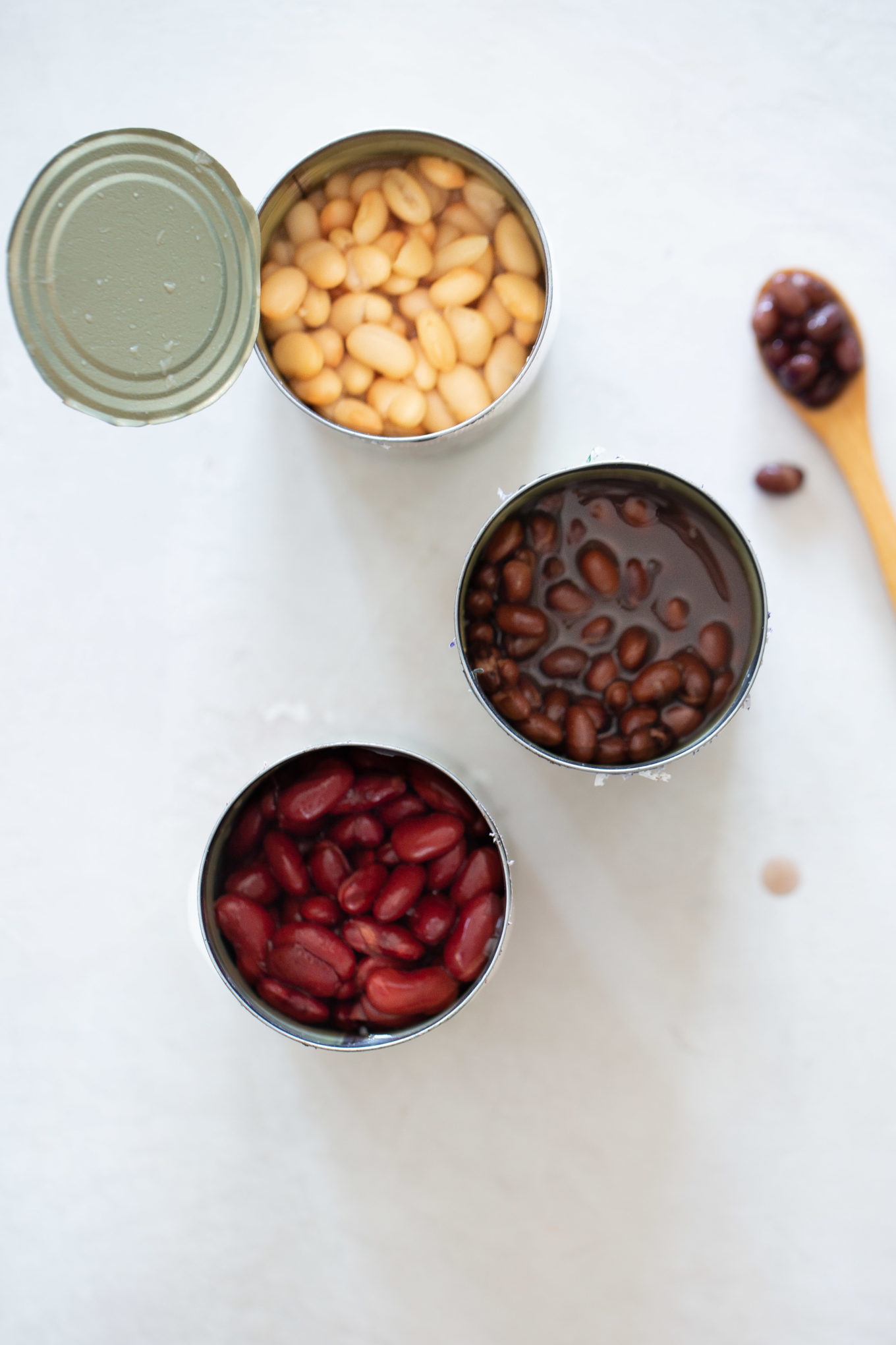 three cans of different beans