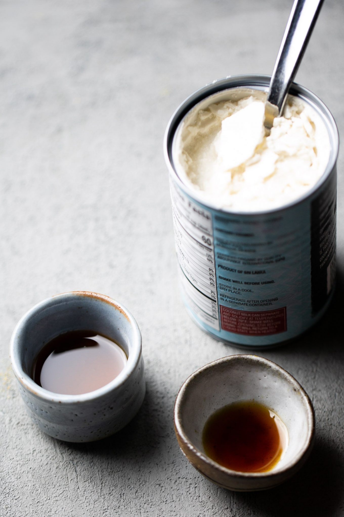 can of coconut milk, maple syrup and vanilla