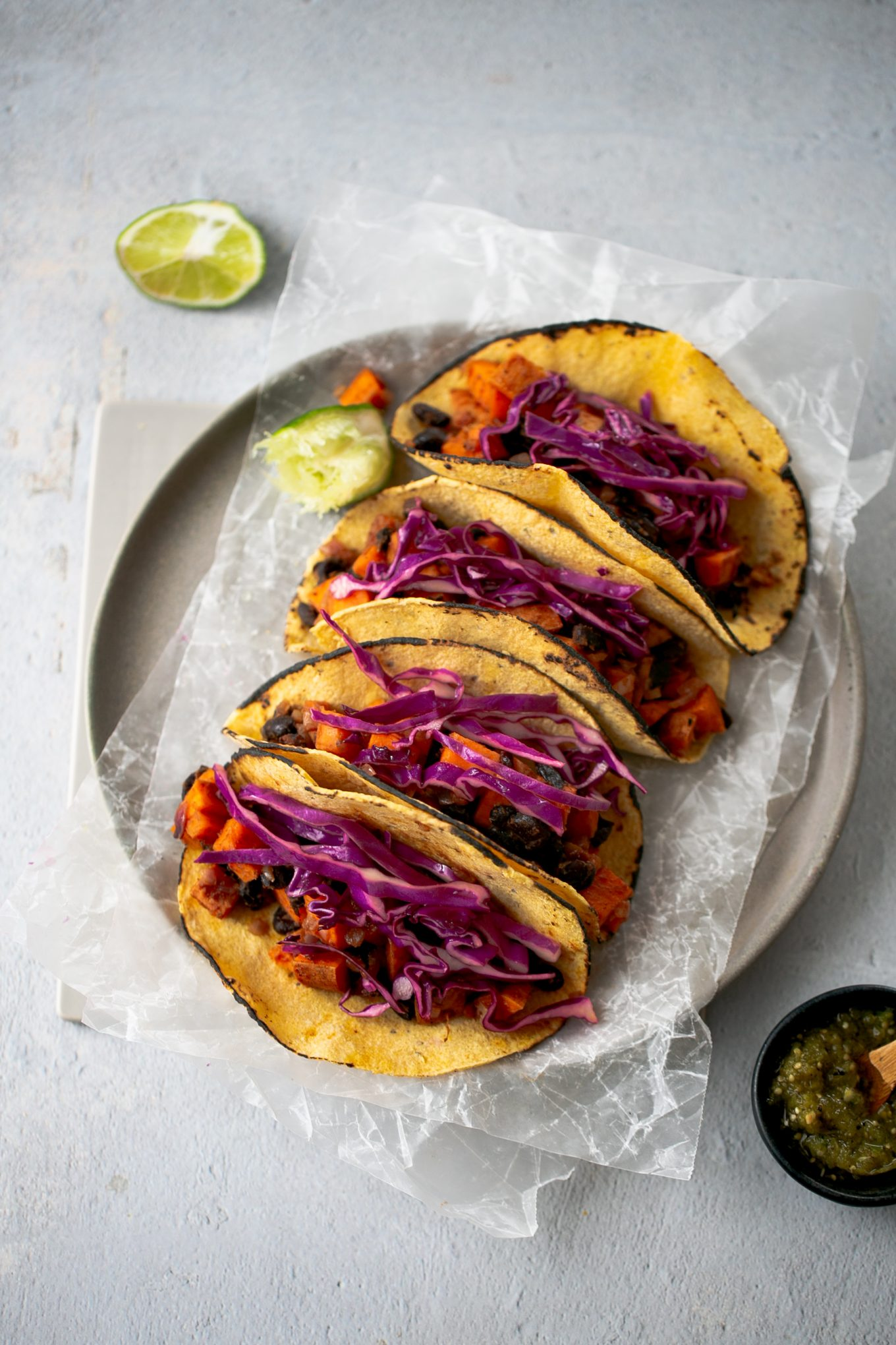 sweet potato and black beans tacos with red cabbage and salsa verde
