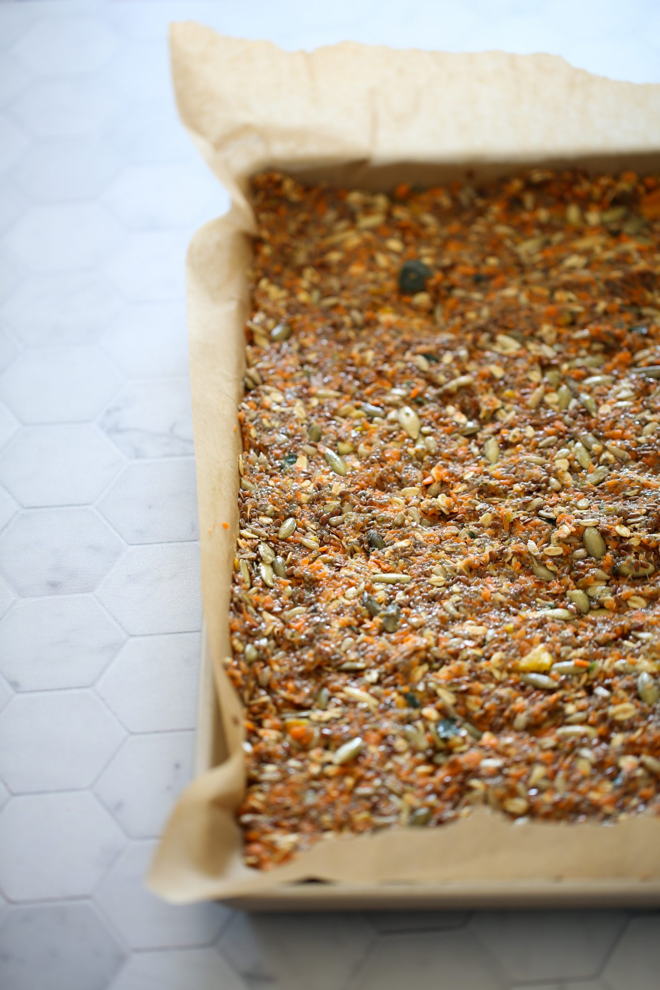 carrot juice crackers on a baking sheet before putting them in the oven