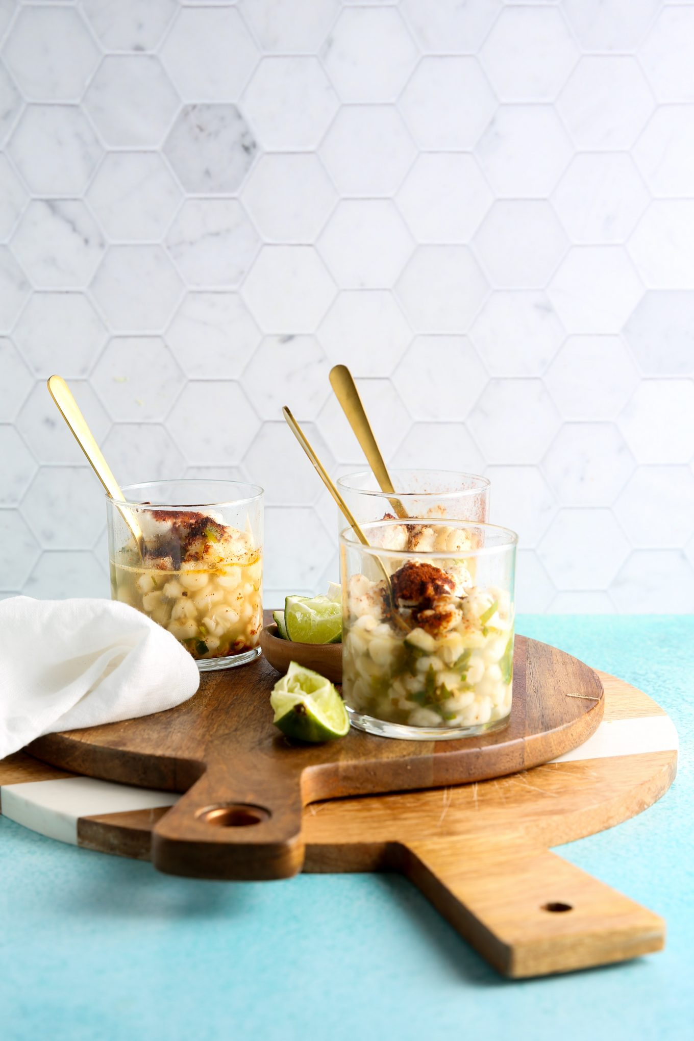 three cglass cups with esquites